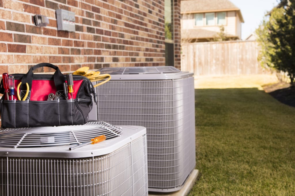 tool bag on outdoor air conditioner units